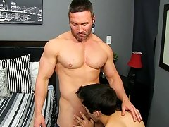 He gets on his knees and gargles Brock's man meat before the muscled stud hauls him up onto the sofa to blow his lollipop and munch his ass.