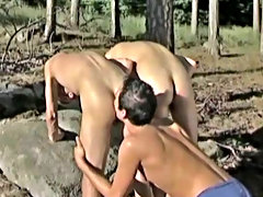 As one guy lies on a capital rock, his buddy kneels and sucks his throbbing cock free gay pic outdoors