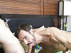 Although muscle daddy Bryan Slater doesn't normally hook up with young chaps like Timo Garrett, once the boy has his hot throat on that large dad